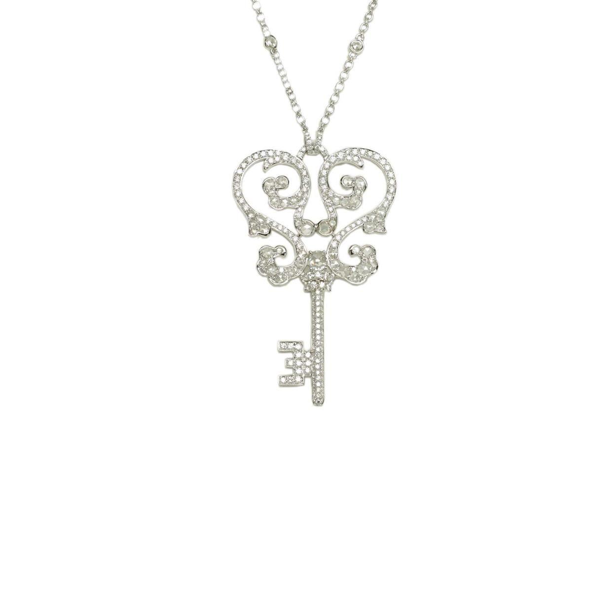 14 karat white gold and pave diamond key pendant